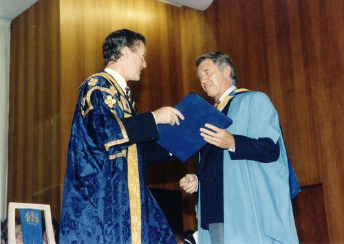 John Daniel and honorary graduate Don McCullin